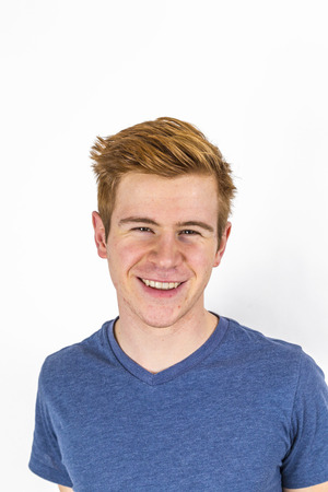 portrait of cool boy with red hair posing in studio