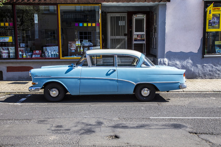 SCHOTTEN, GERMANY -AUG 30, 2015: old Opel Rekord parks at a street in Schotten, Germany. The car was first built in 1953 and sold more than 10 mio times. Publikacyjne