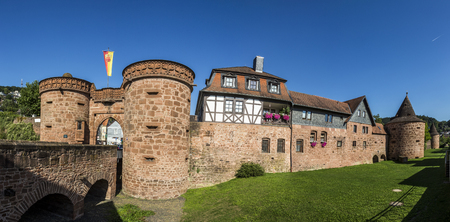hesse: BUEDINGEN, GERMANY - AUG 30, 2015: old city wall with Jerusalem gate in Buedingen, Germany. By 1724 there was a suburb at the Jerusalem Gate where Huguenots, Waldensians, sectarians, and other separationists lived.