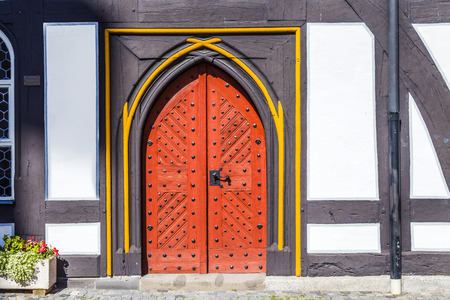 mention: SCHOTTEN, GERMANY - AUG 30, 2015: old door at medieval houses in Schotten, Germany. Schotten had its first documentary mention in 778. Editorial