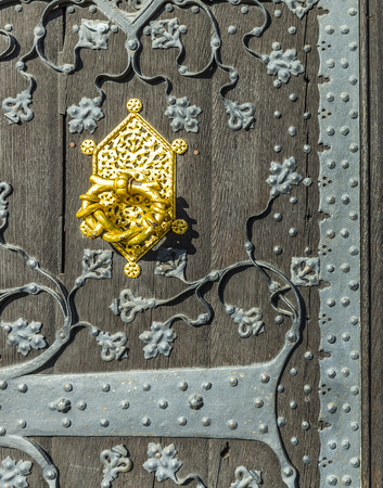 townhall: detail of old wooden door of townhall on Roemerberg square in Frankfurt