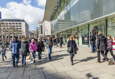 urban people: FRANKFURT, GERMANY - FEB 28, 2015: people walk along the Zeil in Midday in Frankfurt, Germany. Since the 19th century it is of the most famous and busiest shopping streets in Germany.