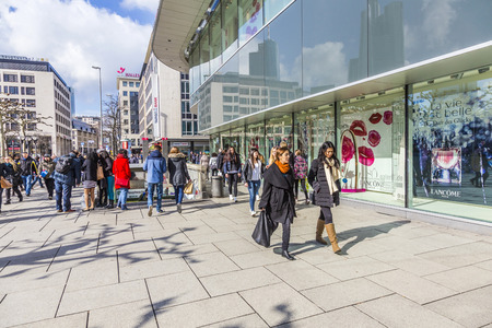 paveway: FRANKFURT, GERMANY - FEB 28, 2015: people walk along the Zeil in Midday in Frankfurt, Germany. Since the 19th century it is of the most famous and busiest shopping streets in Germany.