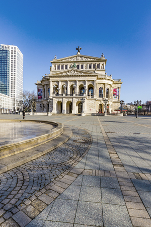 oper: FRANKFURT, GERMANY - APR, 26: people at Alte Oper at Frankfurt, Germany on Apr 26, 2014. It was inaugurated in 1880 but destroyed by bombs in 1944. It was rebuilt and opening again in 1981.