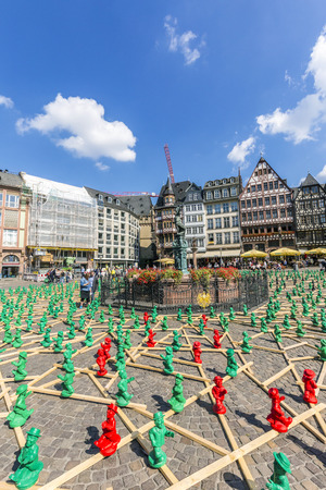 roemer: FRANKFURT, GERMANY - SEP 11, 2015: figures from Ottmar Hoerl to celebrate the 25th anniversary of Germanys reunion in Frankfurt, Germany on public places.