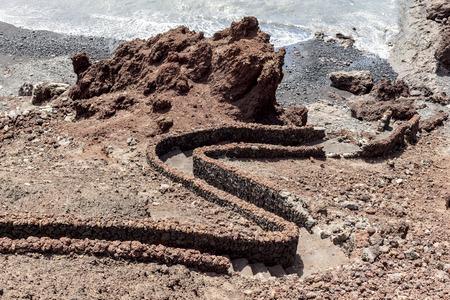golfo: black beach with pebble stones at El Golfo in lanzarote Stock Photo
