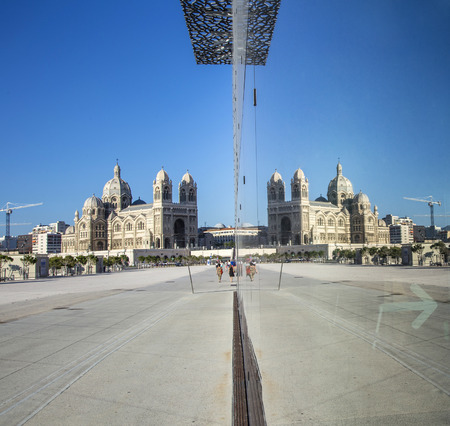 ethnology: MARSEILLE, FRANCE - MAY 11, 2015 : modern building of Museum of European and Mediterranean Civilizations with reflection of cathedral. It was  inaugurated on 2013 when the city was the European Capital of Culture.