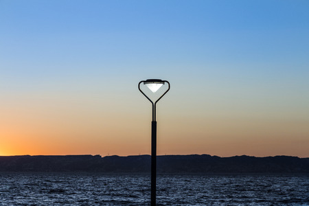 marseille: lantern with burning light at sunset at the Corniche, Marseille Stock Photo