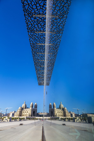 civilizations: MARSEILLE, FRANCE - MAY 11, 2015 : modern building of Museum of European and Mediterranean Civilizations with reflection of cathedral. It was  inaugurated on 2013 when the city was the European Capital of Culture.