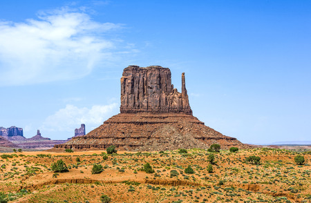 butte: WEst Mittens Butte is a giant sandstone formation in the Monument valley