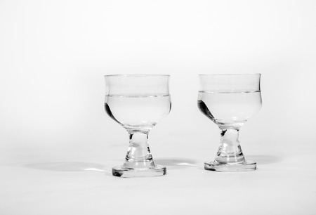 vasos de agua: simple  glass isolated on white with water Foto de archivo