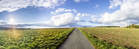 feld: rural landscape with fields and clouds in bright sunset Stock Photo