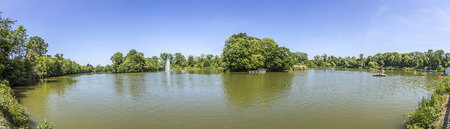 planned: BAD NAUHEIM, GERMANY - JUNE 4, 2015: people enjoy the boat trip at the lake in Bad Nauheims Kurpark. The Kurpark was planned by architect Heinrich Siesmayers. Editorial