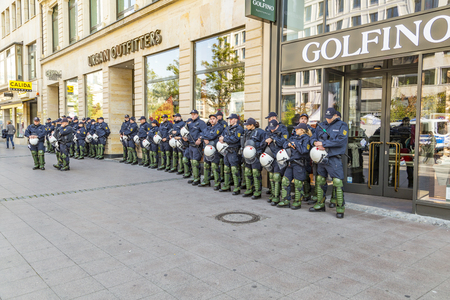 standby: FRANKFURT, GERMANY - OCT 3, 2015: police on standby to assist at anniversary of German Unity in Frankfurt. 1 million people watch the celebration of 25th day of German unity in Frankfurt.