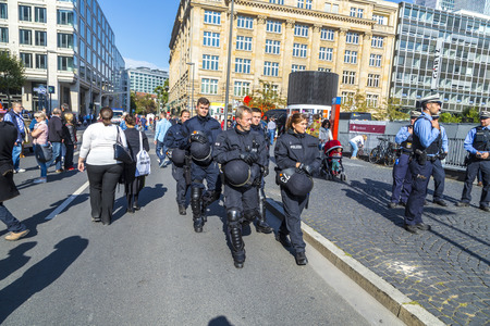 police: FRANKFURT, GERMANY - OCT 3, 2015: police protects the event German unity day in Frankfurt. One million people watch the celebration of 25th day of German unity. Editorial