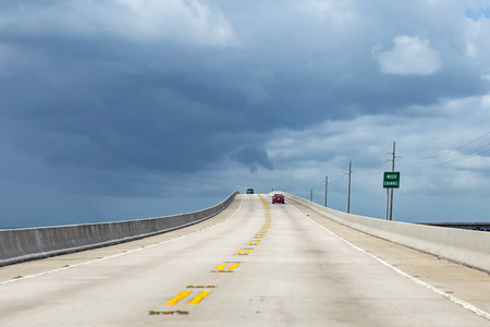 miles: new part of the seven miles bridge under cloudy sky