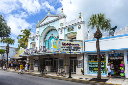 west usa: KEY WEST, USA - AUG 26, 2014: people at Key West cinema theater Strand in Key West, Florida, USA, It is a historic cinema but still in use.