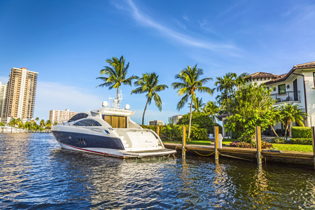 fort lauderdale: FORT LAUDERDALE, USA - AUG 20, 2014:  Boats at waterfront homes in Fort Lauderdale. There are 165 miles of waterways within the city limits.