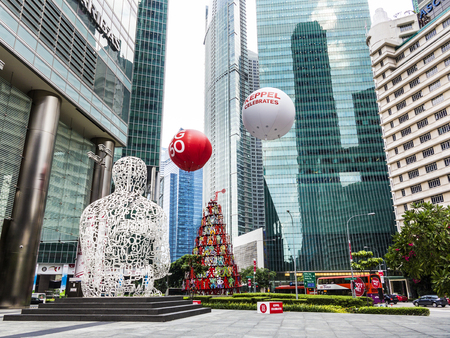 SINGAPORE - AUG 11, 2015: sculpture Singapore soul from Jaume Plensa in the financial Center in Singapore. Singapore soul was created in 2011 by Jaume Plensa.