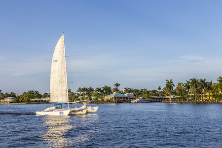 river boat: FORT LAUDERDALE, USA - AUG 20, 2014: Luxurious waterfront home in Fort Lauderdale, USA. There are 165 miles of waterways within the city limits and 9,8 percent of the city is covered by water. Editorial