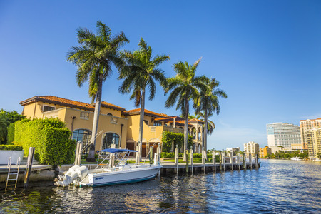 canal houses: FORT LAUDERDALE, USA - AUG 20, 2014:  Boats at waterfront homes in Fort Lauderdale. There are 165 miles of waterways within the city limits.
