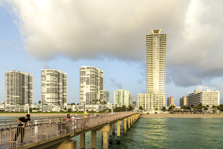 isles: SUNNY ISLES BEACH, USA - AUG 17, 2014: people catch fishes at  the pier in Sunny Isles Beach, USA. In 1936, Milwaukee malt magnate Kurtis built the Sunny Isles pier. Editorial