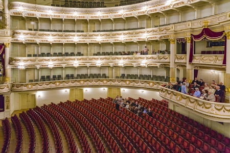 oper: DRESDEN, GERMANY - SEP 17, 2008: people visit Semper Opera from inside in  Dresden, Germany.he opera house was originally built by the architect Gottfried Semper in 1841.