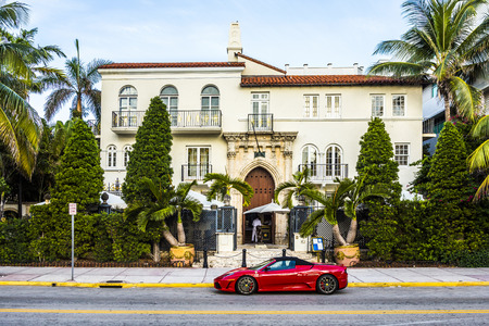 MIAMI, USA - AUG 20, 2014: Ferrari in front of Versace mansion. In 1997 the world gasped as Gianni Versace was shot to death on the doorstep of his Miami South Beach mansion in Miami, USA.