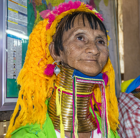 necked woman: NYAUNG SHWE, MYANMAR - AUG 16, 2015: portrait of Padaung tribe woman in Nyaungshwe, Myanmar. Padaung is a Shan term for the Kayan Lahwi people. Editorial