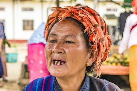 pagan: PAGAN, MYANMAR - AUG 16, 2015: portrait of old Burmese woman in Pagan, Myanmar. She lost her teeth due to missing medical assistance in Myanmar.