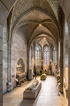 artefacts: NEW YORK, USA - OCT 22, 2015: people visit the Sanctuary at the Cloisters museum in New York, USA. The cloisters was built by original european  artefacts by Rockefeller.