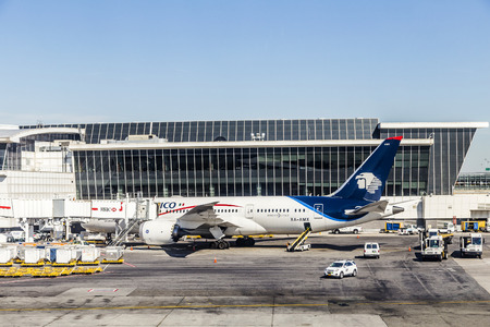 jfk: NEW YORK, USA - OCT 20, 2015: dreamliner from Aeromexico at Terminal 4 with loading equipment at JFK Airport in NY. 1963 the airport was rededicated John F. Kennedy International Airport.