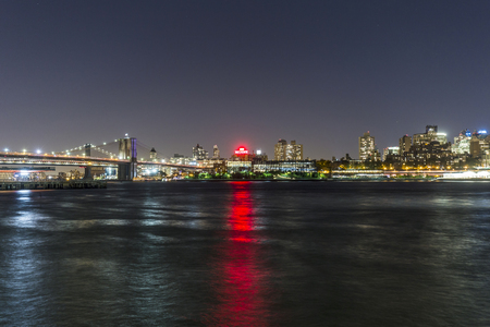 boroughs: NEW YORK, USA - OCT 20, 2015: skyline of Brooklyn with Brooklyn and Manhattan bridge  by night. Brooklyn is the most populous of New York Citys five boroughs, with a Census-estimated 2,6 Mio people.