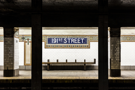 describe: New York, USA - OCT 22, 2015: old vintage sign 191th street Subway Station in the Bronx. Intricate tiles with symbols  in terra cotta describe the place.