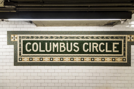 terra cotta: New York, USA - OCT 22, 2015: old vintage sign Columbus circle Subway Station in Manhattan. Intricate tiles with symbols  in terra cotta describe the place.