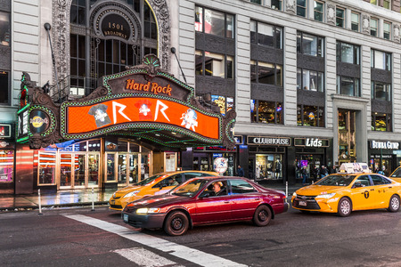 hard times: NEW YORK, USA - OCT 21, 2015: Site of the former the Paramount theater, this landmark Hard Rock Cafe sits in the heart of Times Square in New York City.