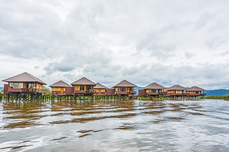 tha: NYAUNGSHWE, MYANMAR - AUG 15, 2015: Shwe Inn Tha floating Hotel at the inle lake offers huts for tourists. The hotel opened in 1996 and is ISO certified (ISO 37).