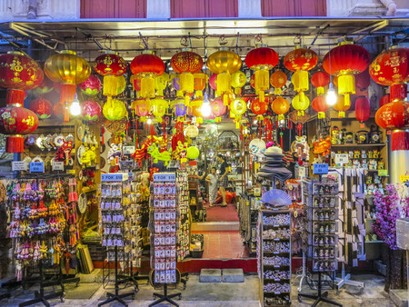 tonight: SINGAPORE, SINGAPORE - AUG 12, 2015: typical chinese shops are open tonight in Singapore. in 2014, 74 percent of the  Singapore population were chinese ethnic.