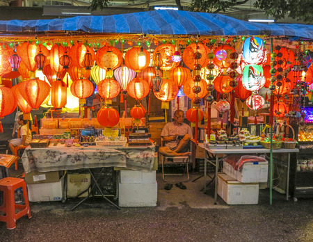 tonight: SINGAPORE, SINGAPORE - AUG 12, 2015: typical chinese shops are open tonight in Singapore, selling chinese lanterns. In 2014, 74 percent of the  Singapore population were chinese ethnic. Editorial