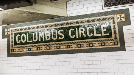 describe: New York, USA - OCT 22, 2015: old vintage sign Columbus circle Subway Station in Manhattan. Intricate tiles with symbols  in terra cotta describe the place.