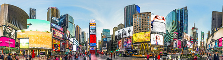 squares: NEW YORK, USA - OCT 21, 2015: Times Square, featured with Broadway Theaters and huge number of LED signs, is a symbol of New York City and the United States.