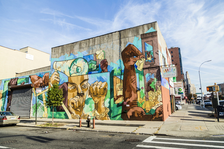 restored: NEW YORK, USA - OCT 21 2015: colorful mural wall painting in New York. Especially in Brooklyn wall painting at the old not restored houses are usual. The murals often tell stories.