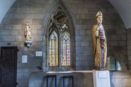 empty tomb: NEW YORK, USA - OCT 22, 2015: religious statue at the Sanctuary at the Cloisters museum in New York, USA. The cloisters was built by original european  artefacts by Rockefeller.