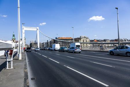 rope bridge: BUDAPEST, HUNGARY - AUG 4, 2008: people cross the old rope bridge in Budapest, Hungary. Budapest is famous for its beautiful Danube bridges.