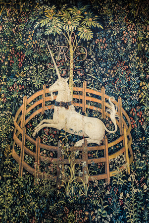 artefacts: NEW YORK, USA - OCT 22, 2015: famous unicorn tapestries in the Cloisters museum in New York, USA. The cloisters was built by original european  artefacts by Rockefeller. Editorial