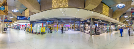 COLOGNE, GERMANY - NOV 11, 2015: people in Passenger Terminal of the Cologne Bonn International Airport (CGN) in Cologne, Germany. 10 mio people use the airport yearly.