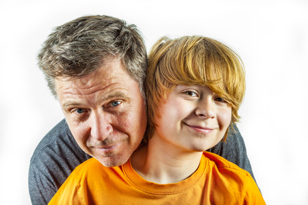 smooching: portrait of father and happy son hugging Stock Photo