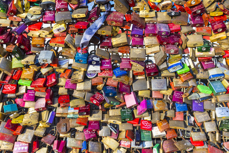 symbolize: COLOGNE, GERMANY - DEC 3, 2013: lockers at the Hohenzollern bridge symbolize love for ever in Cologne, Germany. 40000 lockers of loving couples are on that heavily used railway bridge.