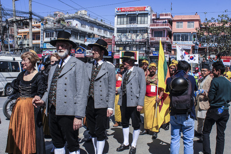 local festivals: KATHMANDU, NEPAL - MARCH 3, 2014: people celebrate carnival in Kathmandu, Nepal. Local and foreign people carry flags from other contries and celebrate the bavarian way. Editorial