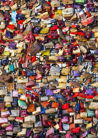 symbolize: COLOGNE, GERMANY - JUNE 15: lockers at the Hohenzollern bridge symbolize forever love on JUNE 15,2013, Cologne, Germany. was constructed between 1907 and 1911 after the old bridge was demolished Editorial